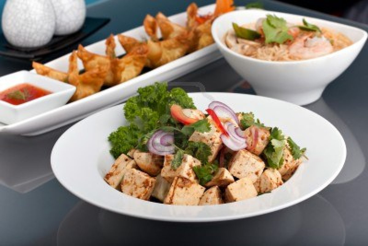 10552656-a-nice-assortment-of-thai-food-and-appetizers-presented-beautifully-with-fancy-garnish-with-copy-spa